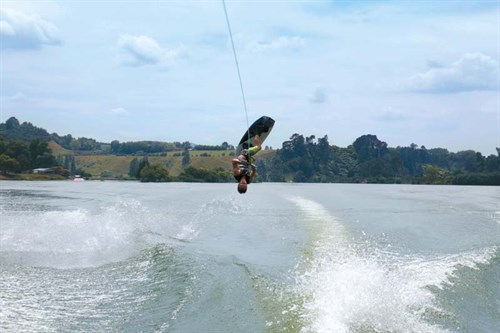 Wakeboarder behind Nautique boat